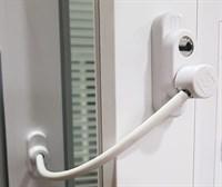 Блокиратор поворота с тросиком и ключом белый